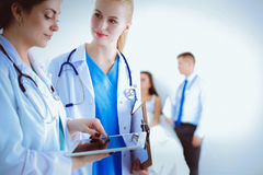 Young woman doctor holding a tablet pc Royalty Free Stock Image