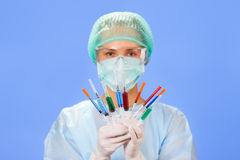 Young woman doctor with many syringes Stock Photo