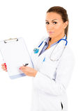 Young woman doctor / nurse showing empty blank clipboard sign with copy space for text Royalty Free Stock Photo