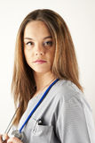 Young woman doctor or nurse wearing scrubs Royalty Free Stock Image