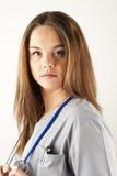 Young woman doctor or nurse wearing scrubs. Young woman doctor or nurse wearing gray scrubs Royalty Free Stock Image