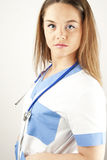 Young woman doctor or nurse wearing scrubs Royalty Free Stock Photos