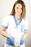 Young woman doctor or nurse wearing scrubs Royalty Free Stock Images