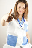 Young woman doctor or nurse wearing scrubs Stock Images