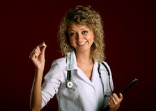 Young woman doctor with a pill Royalty Free Stock Photos