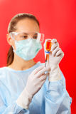 Young woman doctor preparing injection Royalty Free Stock Images