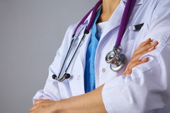 Young woman doctor standing  with crossed arms Stock Image