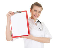 Young woman doctor with stethoscope keeping clipboard Stock Photo