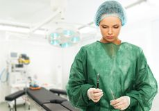 Young woman doctor in surgery room Royalty Free Stock Photos