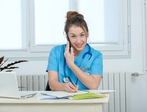 Young woman doctor talking on the phone. Pretty young woman doctor talking on the phone Stock Photo