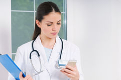 Free Young Woman Doctor With Medicine Equipment Working At Hospital Royalty Free Stock Image - 55450366