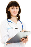 Young woman doctor writes a pen Stock Photos