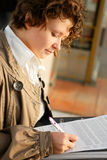 Young woman with documents Stock Images