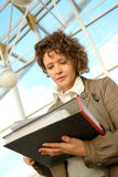 Young woman with documents Stock Photo