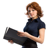 The young woman with documents. The young woman in a business dress with documents in hands. White background Stock Photos