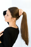 Young woman does a hairdress Stock Image