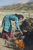 Young woman does housework circa Isfahan, Iran. Royalty Free Stock Photography