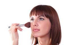 Young woman does make-up Royalty Free Stock Images