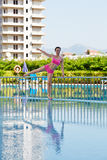 Young woman does morning exercises on poolside Royalty Free Stock Photo