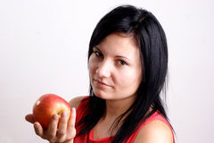 young woman does not like this apple Stock Images