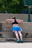 Young Woman Does Pushups Against Concrete Steps Stock Photos