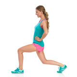 Young Woman Does Split Squat. Side View Royalty Free Stock Images