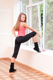 Young woman does stretching Stock Photo