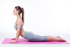 Young woman does yoga Stock Photo