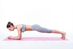 Young woman does yoga Stock Photography