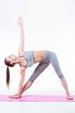 Young woman does yoga Royalty Free Stock Image