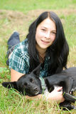 Young woman with dog Stock Photography