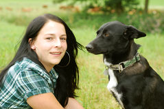 Young woman with dog Royalty Free Stock Image