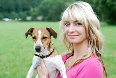 Young woman with dog Stock Images