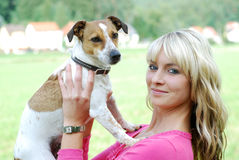 Young woman with dog Royalty Free Stock Photo