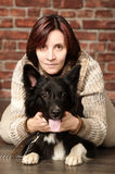 Young woman with dog Royalty Free Stock Photos