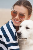 Young woman with a dog on a deserted beach Royalty Free Stock Photography