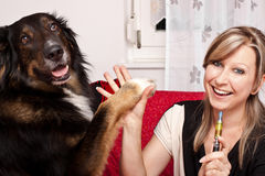 Young woman with dog and e-cigarette Stock Images