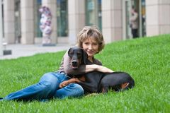 The young woman with a dog on a grass Stock Photo