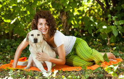 Young woman and dog Royalty Free Stock Image