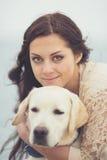 Young woman, dog labrador Stock Photography
