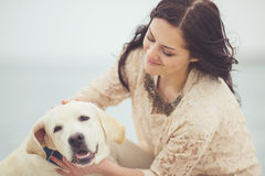Young woman, dog labrador Royalty Free Stock Image