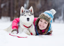 Young woman with dog outdoor. Young woman with huski dog outdoor Royalty Free Stock Images