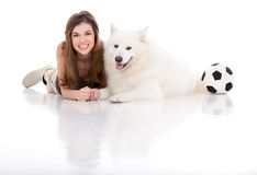 Young woman and dog posing, with football Stock Photo