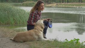 Young woman and dog is resting together stock video