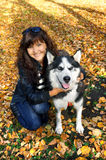 Young woman and dog siberian husky stock images