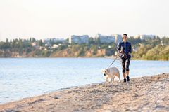 Young woman with dog together on beach. Pet care. Young woman with her dog together on beach. Pet care Stock Photos