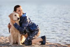 Young woman with dog together on beach. Pet care. Young woman with her dog together on beach. Pet care Royalty Free Stock Image