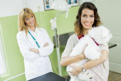 Young woman with a dog at veterinarian Stock Photos