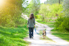 Young woman with dog walking in the forest Stock Photography