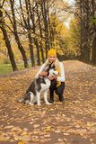 Young woman and dog walking. Outdoors Royalty Free Stock Photos